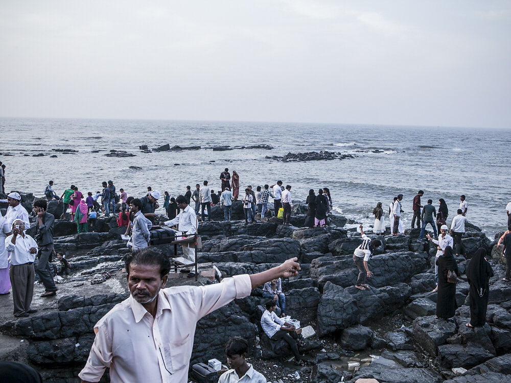 Mumbai Mirror, 2013. People outside of Haji Ali Dargah mosque.
