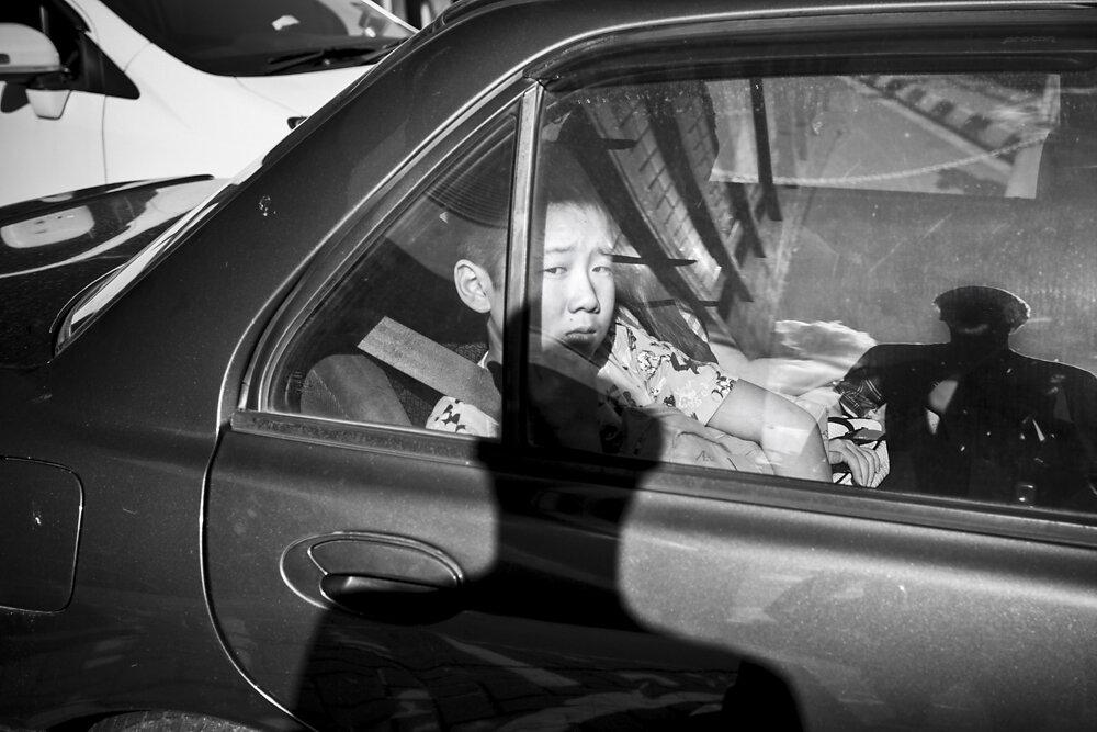 Malaysia, 2012. A boy in a traffic jam.